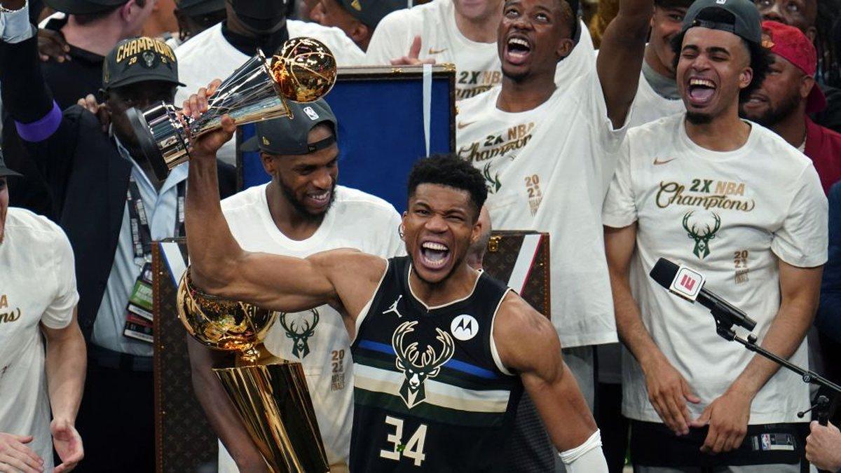 Milwaukee Bucks forward Giannis Antetokounmpo (34) holds the finals MVP trophy after the Bucks...