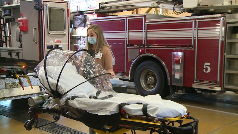 Marshfield Medical Center EMS Coordinator presenting Eau Claire Fire & Rescue with new FERNO...