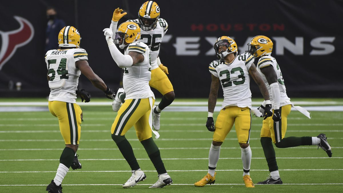 Members of the Green Bay Packers celebrate during the second half of an NFL football game...