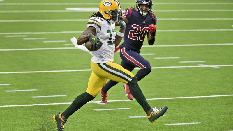 Green Bay Packers wide receiver Davante Adams (17) runs for the end zone past Houston Texans...