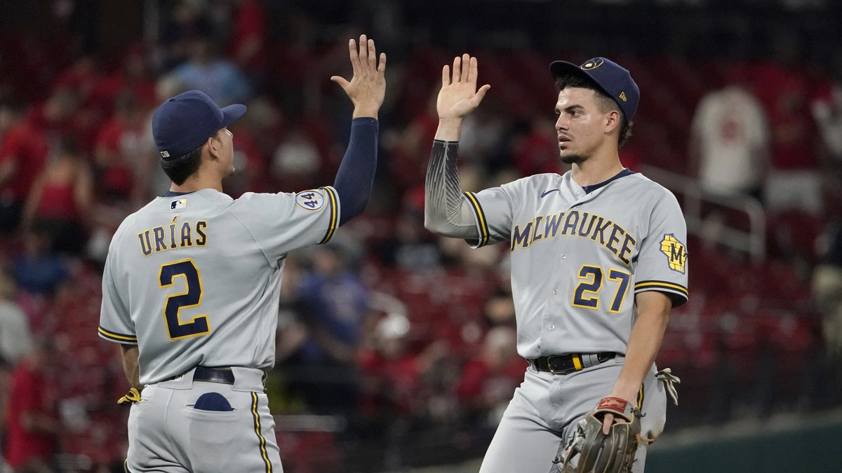 Milwaukee Brewers' Willy Adames (27) and Luis Urias (2) celebrate a 4-0 victory over the St....