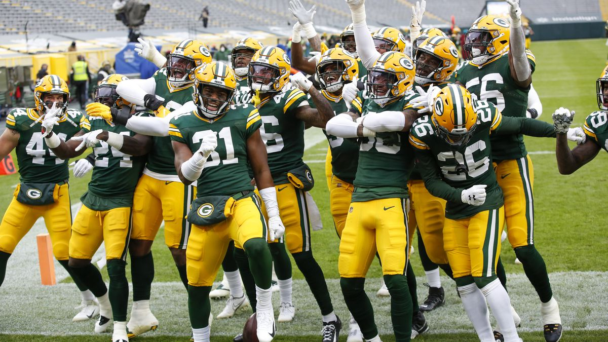The Green Bay Packers defense celebrates after an interception and touchdown return during the...