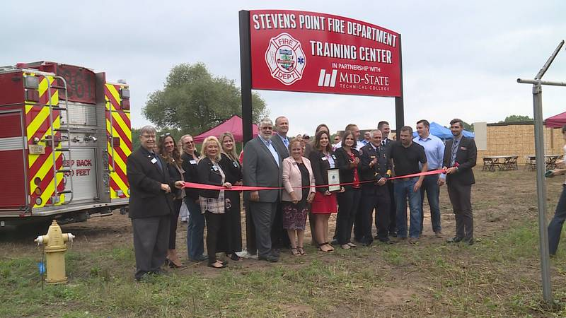 Stakeholders pose for a picture at the ribbon cutting ceremony at Stevens Point Fire Department...