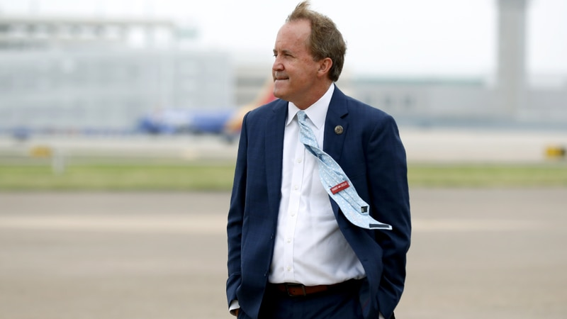 FILE - In this June 28, 2020, file photo, Texas Attorney General Ken Paxton waits on the flight...