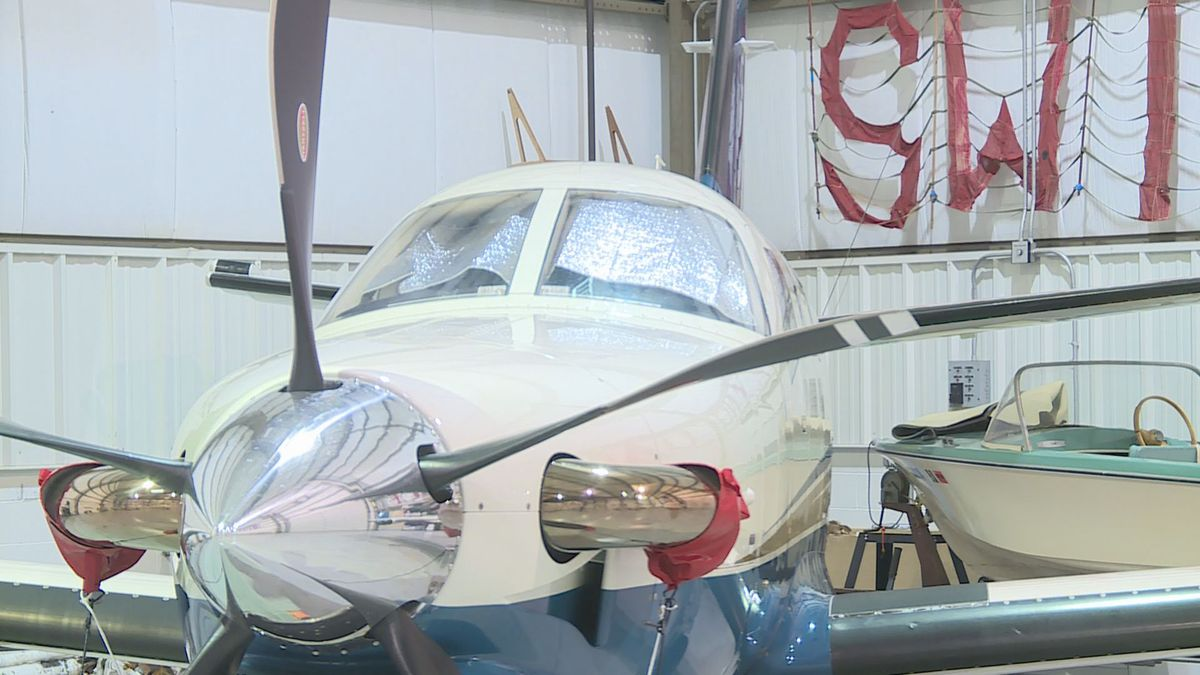 A plane sits inside one of the Wausau Downtown Airport garages on Jan.30, 2019. (WSAW Photo)