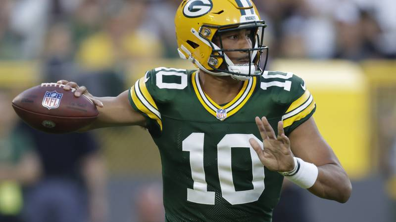 Green Bay Packers' Jordan Love throws a pass during the first half of a preseason NFL football...