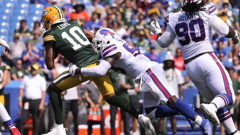 Green Bay Packers quarterback Jordan Love (10) is sacked by Buffalo Bills linebacker Andre...