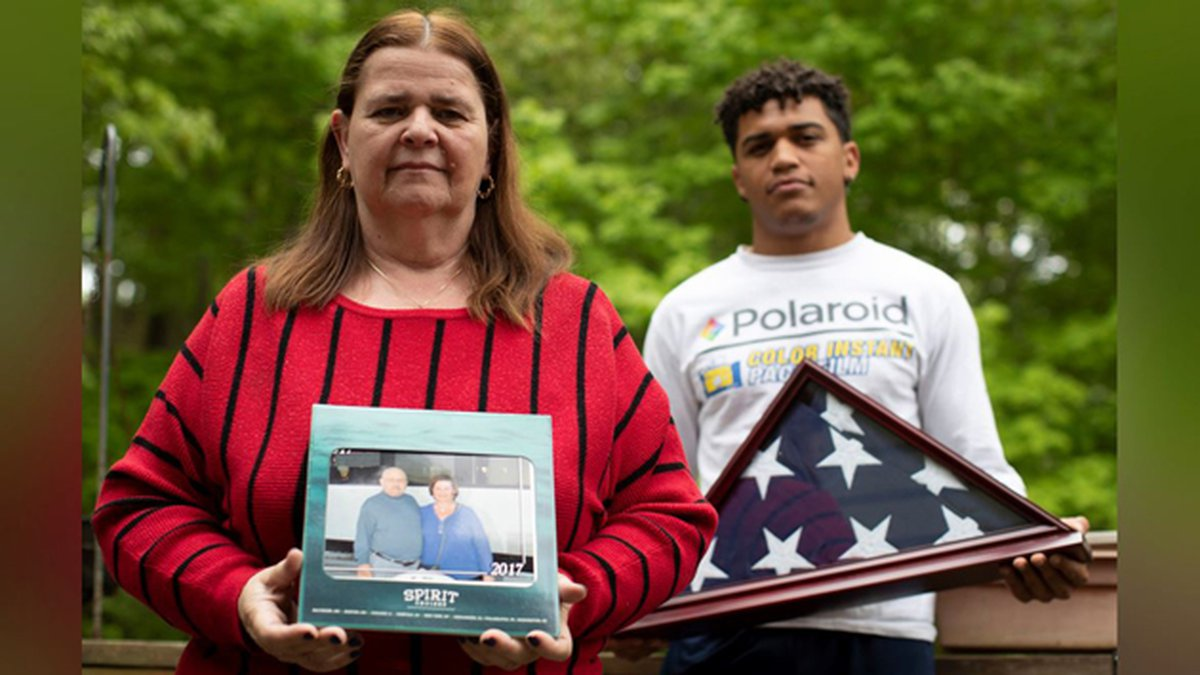 In this Friday, May 22, 2020 photo, Florence Hopp, left, holds a photograph of herself and her...