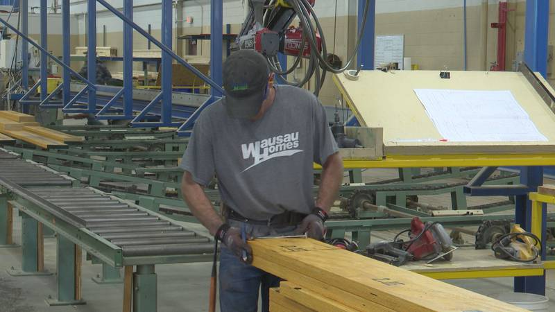A man builds  house components at Wausau Homes