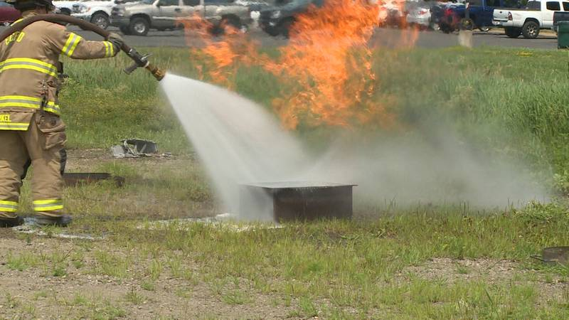 An Eau Claire firefighter putting out a fire using F-500 in a demonstration in Eau Claire, Wis.