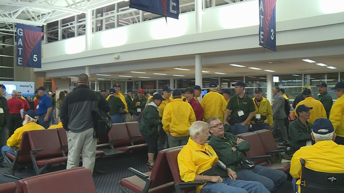 More than 100 verterans and their guardians wait to board the 38th Never Forgotten Honors...