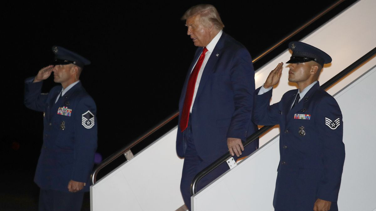 President Donald Trump steps off Air Force One at Andrews Air Force Base, Md., Friday, July 31,...