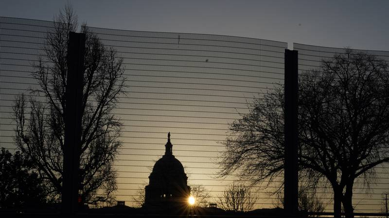FILE - In this March 4, 2021 file photo, the Capitol dome is seen beyond a perimeter security...