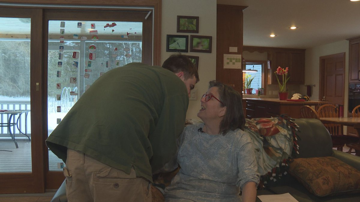 Kathy Meyer embraces her son Matt in their home. (WSAW photo taken 1/8/20)