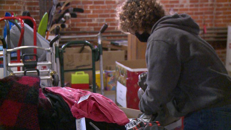 Railynn Barnard sorts clothes she donated to Spirit of Christmas of Chippewa County in Chippewa...