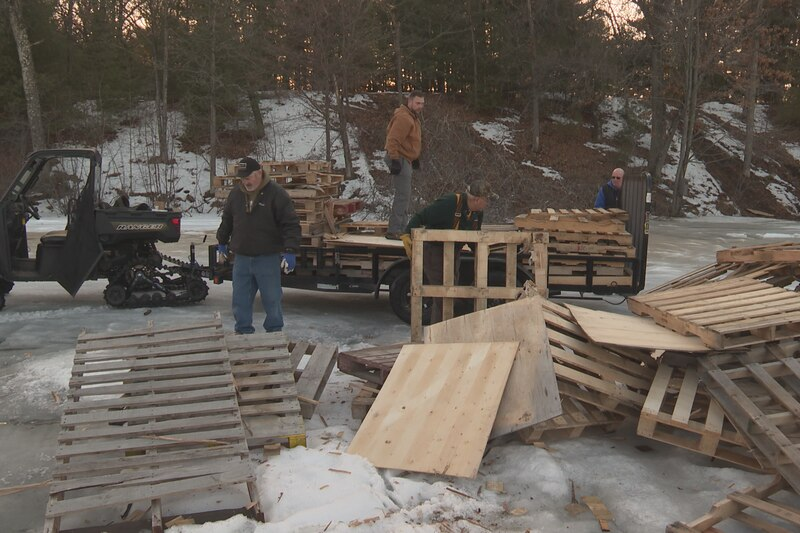 A large pile of palettes and other pieces of trash were left abandoned on the ice.