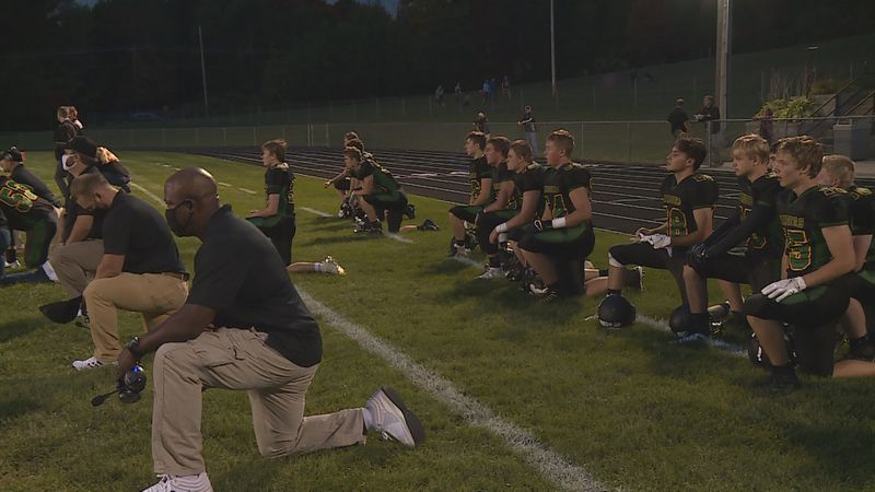 The Wittenberg-Birnamwood football team paying tribute to late teammate Sam Egging by taking a...