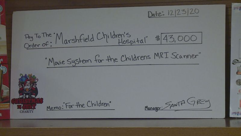 $43,000 check presented by Christmas in July.