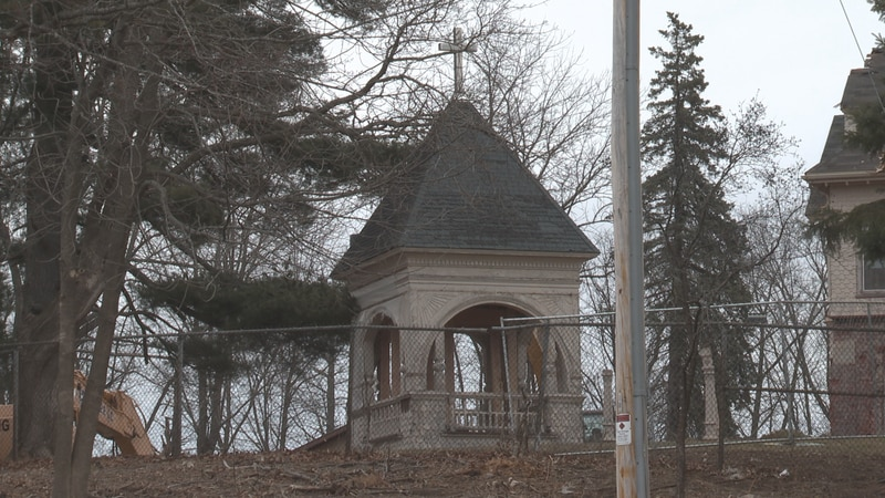 The T.B. Scott mansion tower is finding its final resting place on the River Bend Trail.