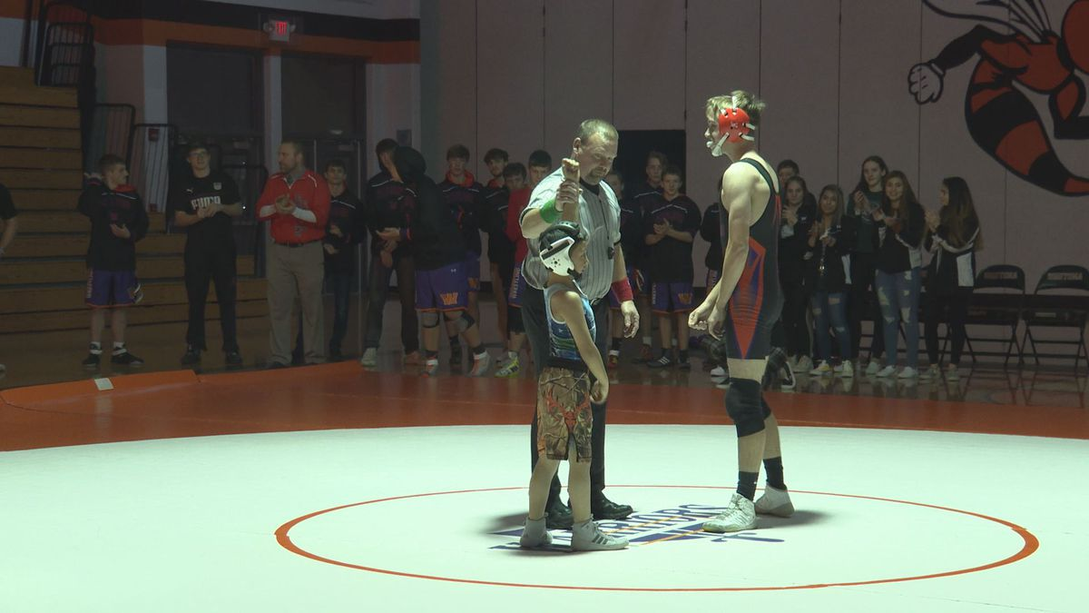 Miguel Duran is declared the winner of his match against Christian Weiss at Wautoma High...