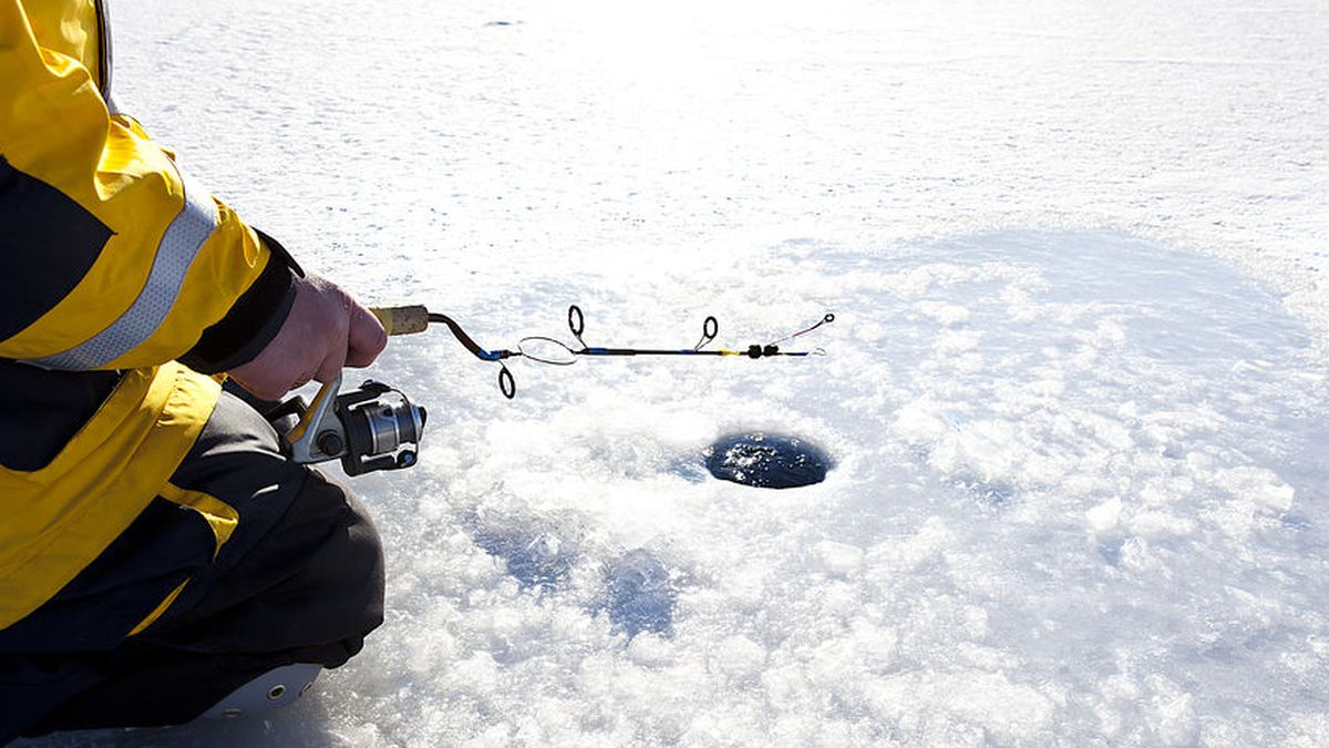 Ice Fishing in winter scene