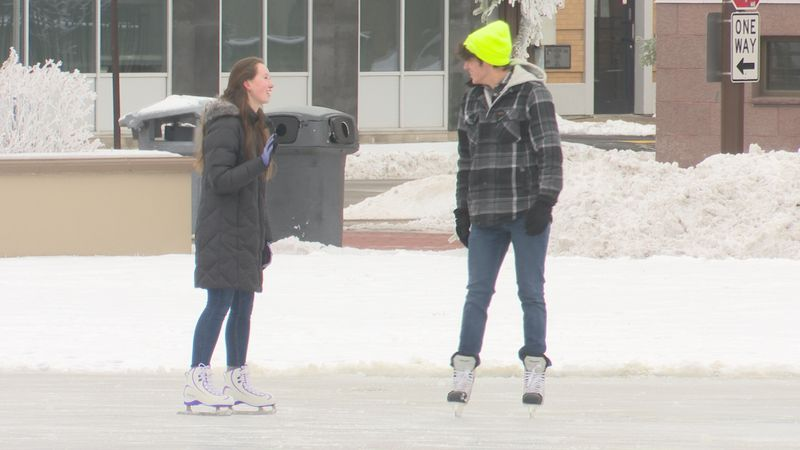 Two skaters enjoy the rink at 400 Block