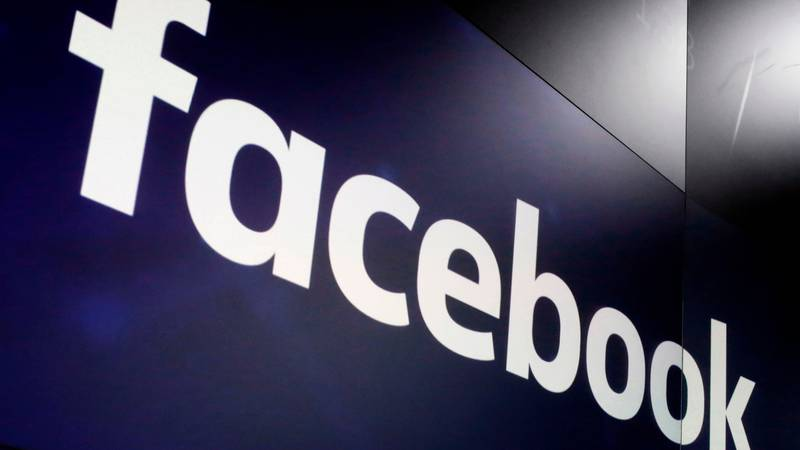 FILE - In this March 29, 2018 file photo, the logo for Facebook appears on screens at the...