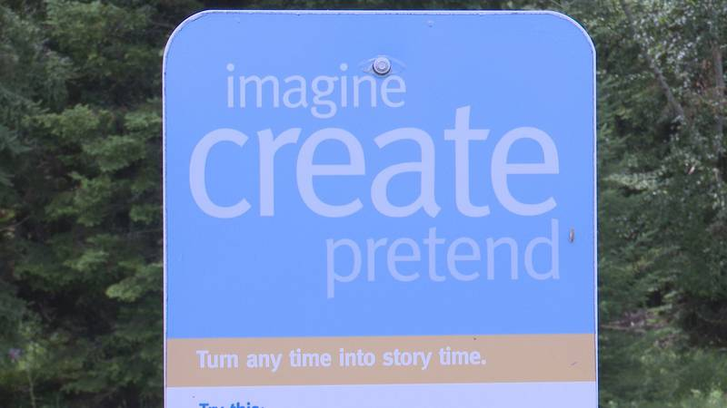 A sign on a Marathon County Learning trail encourages kids to create their own stories.
