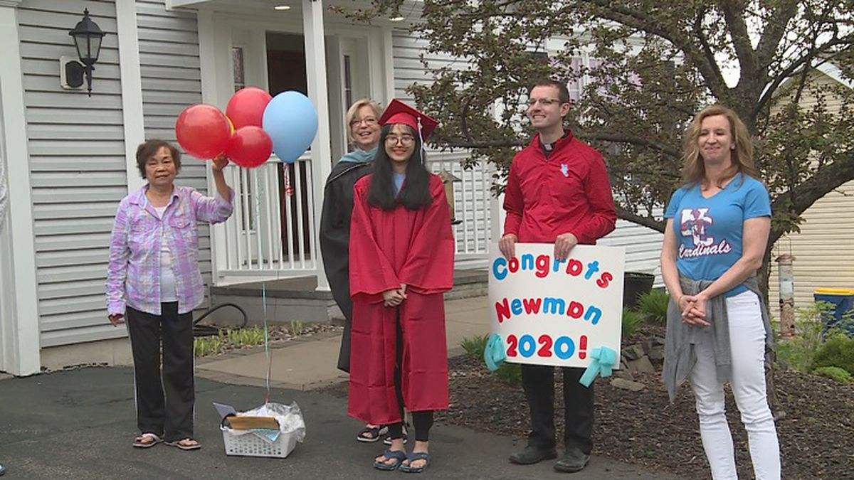 Newman faculty and staff drove to each seniors' house to give out a gift basket on graduation...