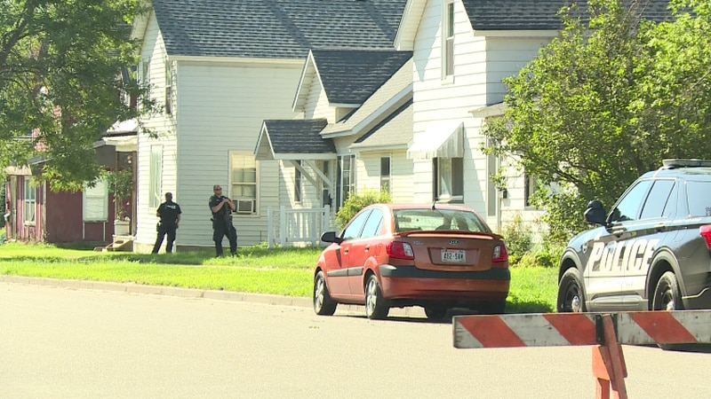 Chippewa Falls Police Department surround are outside this house on Water Street.
