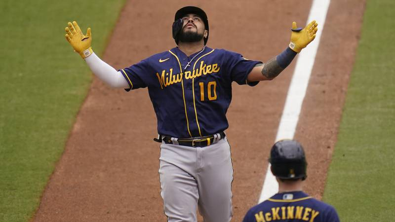 Milwaukee Brewers' Omar Narvaez looks up as he nears the plate on his two-run home run during...