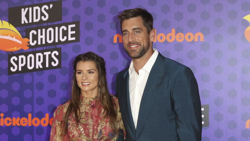 NFL football player Aaron Rodgers, of the Green Bay Packers, right, and Danica Patrick arrive...