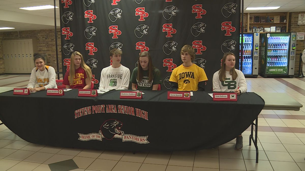 Six high school athletes get ready to sign their letters of commitment at Stevens Point Area Senior High School in Stevens Point, Wisconsin, on November 13, 2019. (WSAW)