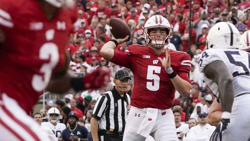 Wisconsin's Graham Mertz throws a pass during the first half of an NCAA college football...
