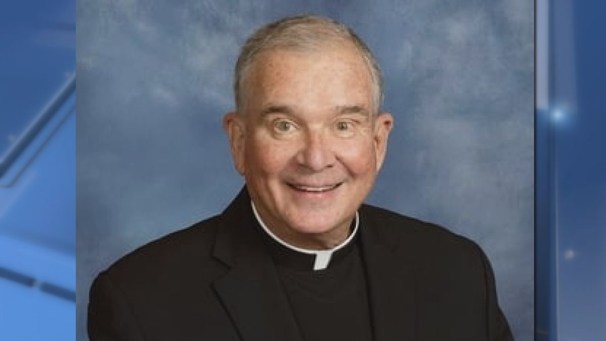 """Longtime Wisconsin Badgers chaplain, Msgr. Michael L. Burke, also known as """"Father Mike"""" died Saturday night."""