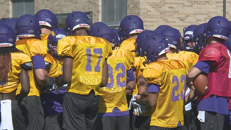 The UW-Stevens Point Football team huddling during a practice on August 16, 2021.