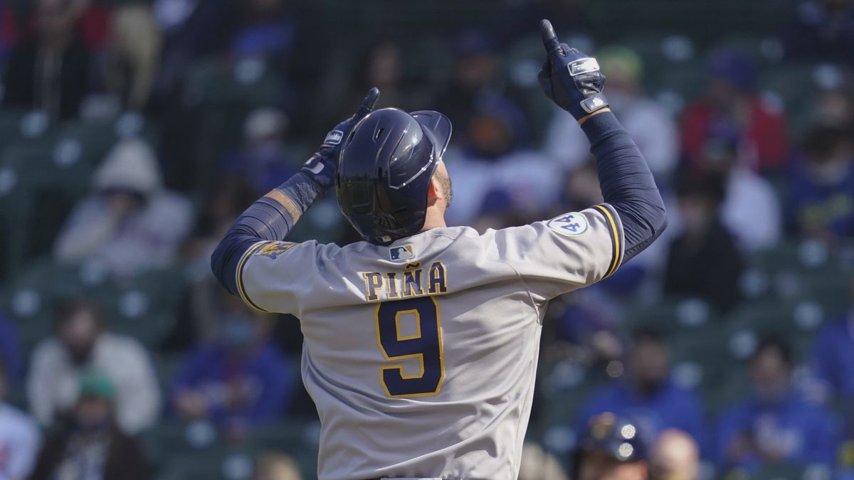 Milwaukee Brewers' Manny Pina celebrates as he rounds the bases after hitting a two-run home...