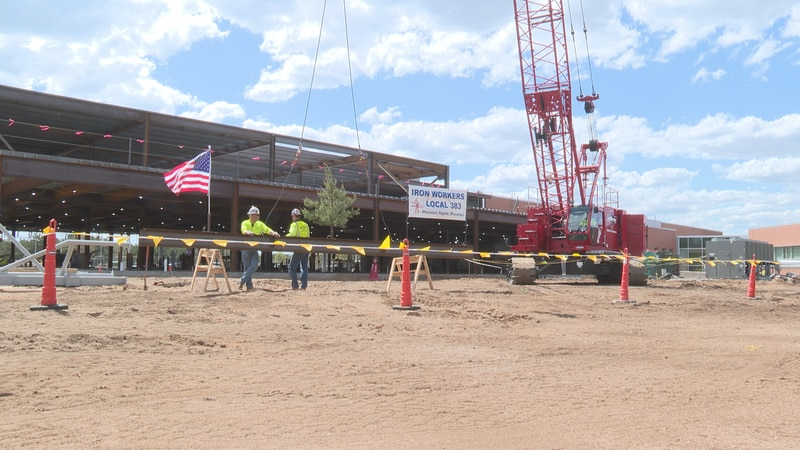 Marshfield clinic wing celebrated their last steel beam being put in.