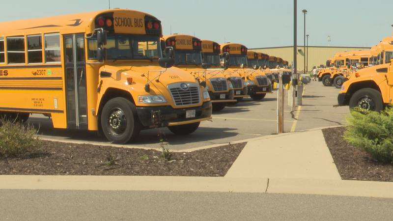 School buses wait for the start of the school year in Weston, Wisconsin