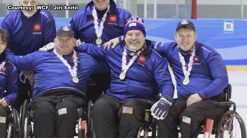 Matt Thums (right) takes a photo with his team after winning gold at the World Wheelchair-B...