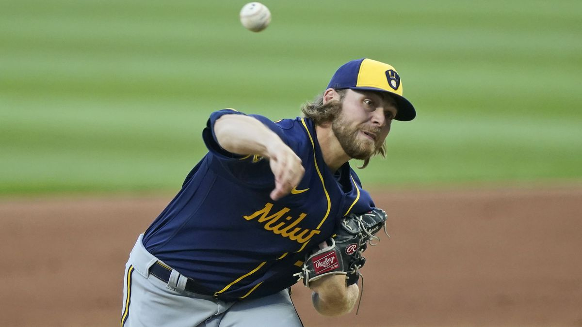 Milwaukee Brewers starting pitcher Corbin Burnes delivers in the first inning in a baseball...