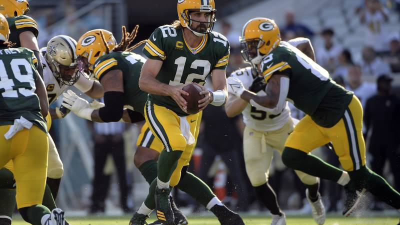 Green Bay Packers quarterback Aaron Rodgers (12) hands off the ball during the second half of...