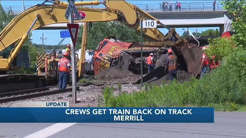 Crews working to rebuild tracks at site of train derailment in Merrill