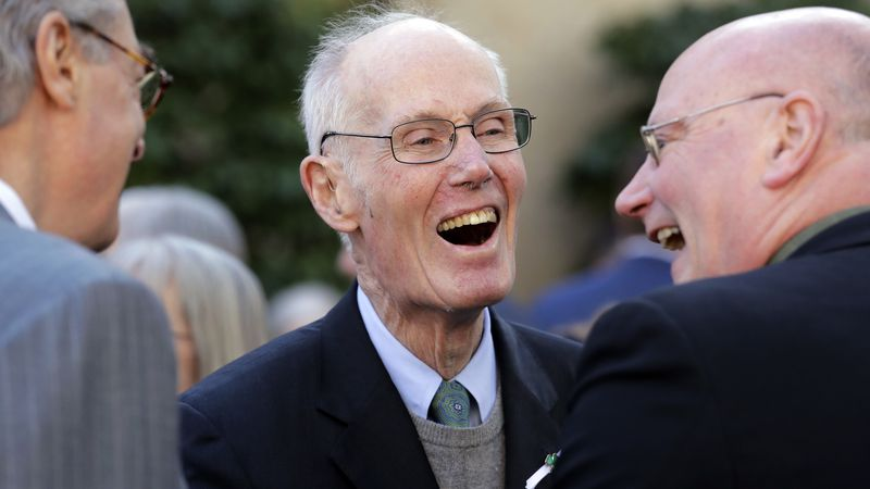 Former U.S. Sen. Slade Gorton shares a smile with friends following a joint funeral Mass for...