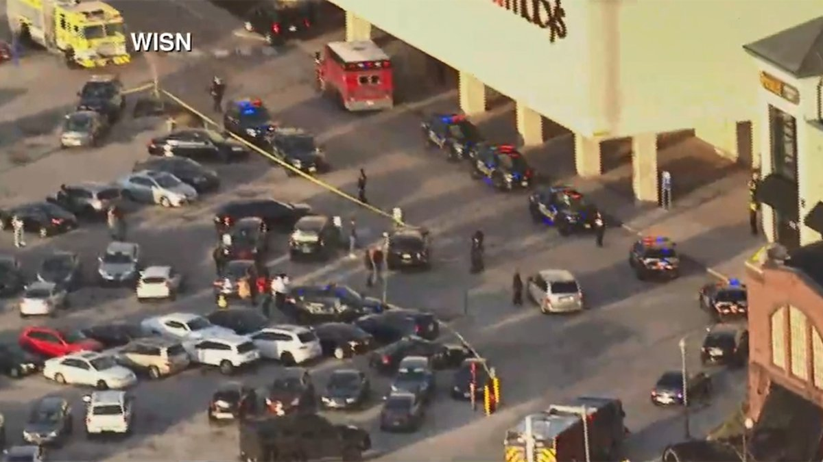 Police respond to the shootings of multiple people at Mayfair Mall in Wauwatosa, Wis., on Nov....