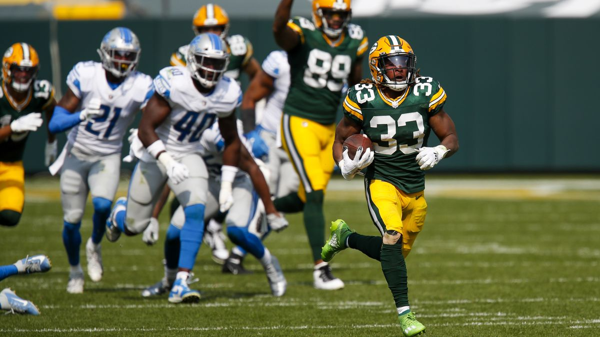 Green Bay Packers' Aaron Jones runs for a touchdown during the second half of an NFL football game against the Detroit Lions Sunday, Sept. 20, 2020, in Green Bay, Wis. (AP Photo/Matt Ludtke)