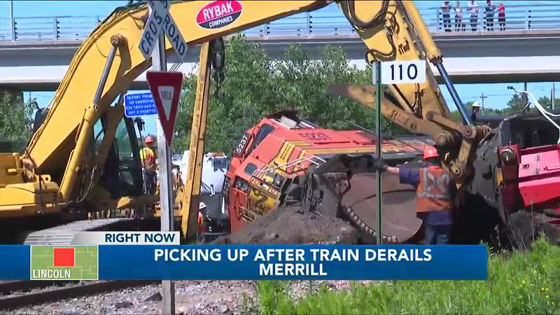 Crews work through the day to clear scene after train cars derail in Merrill