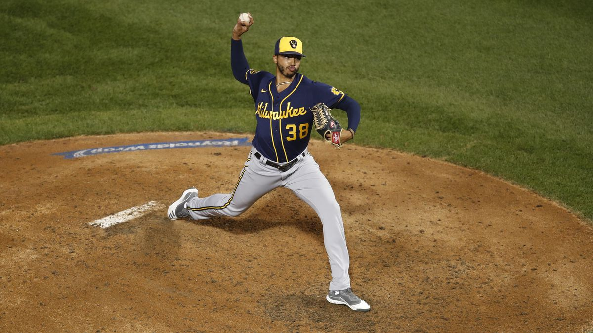 Milwaukee Brewers relief pitcher Devin Williams (38) delivers during a baseball game against...