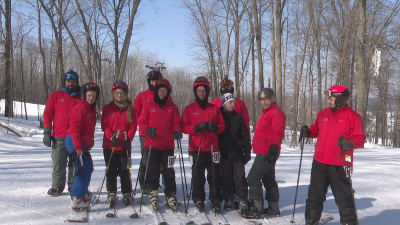 Special Olympics skiers pose for photo at the close of the competition