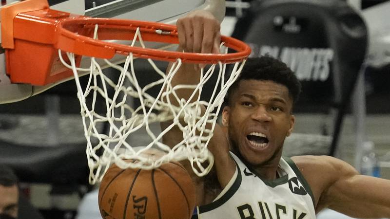Milwaukee Bucks' Giannis Antetokounmpo dunks during the second half of Game 4 of the NBA...